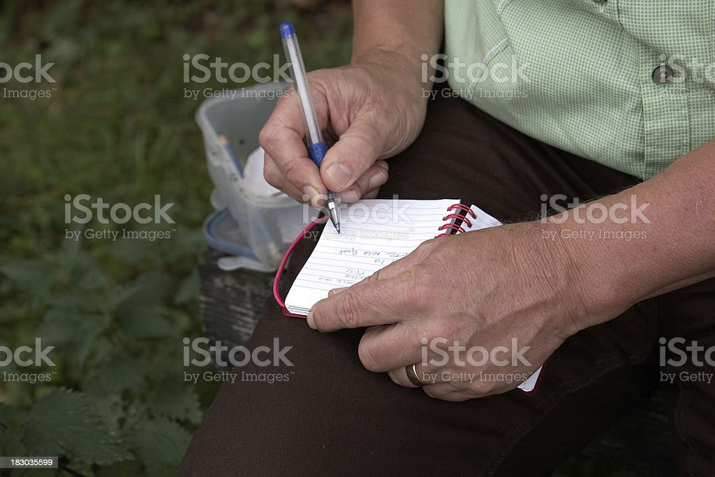 Mature man geocaching stock photo