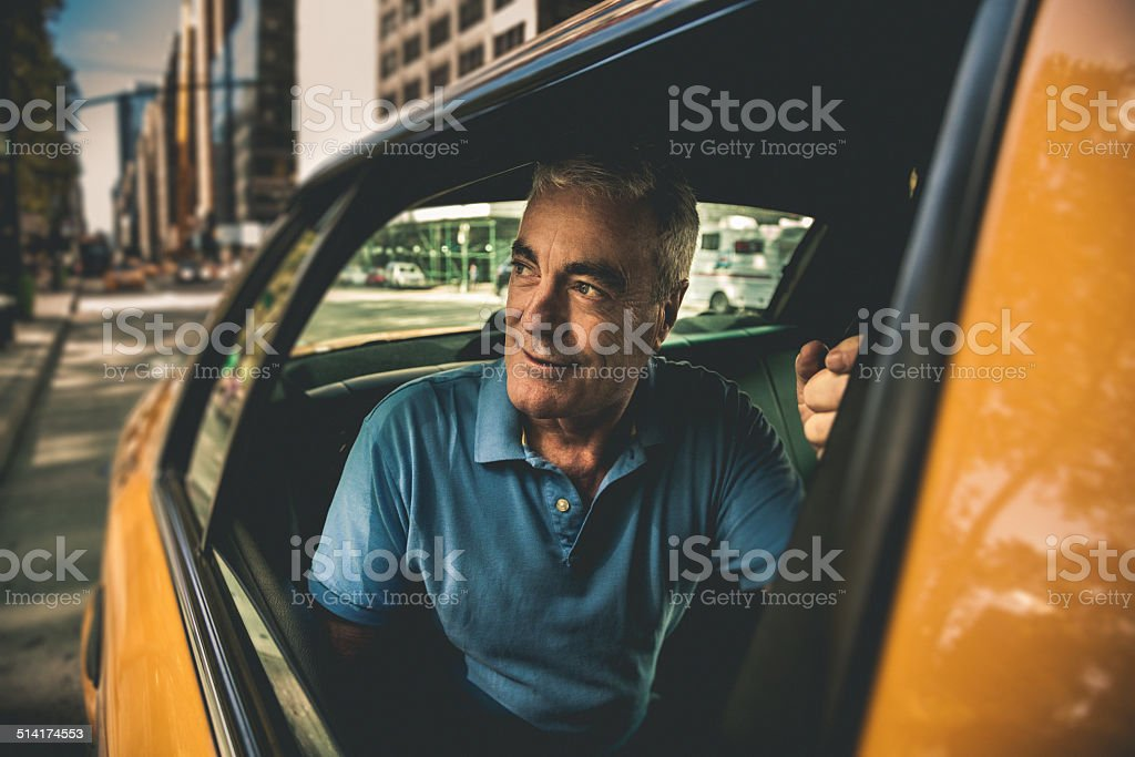 Mature man get on a taxi stock photo