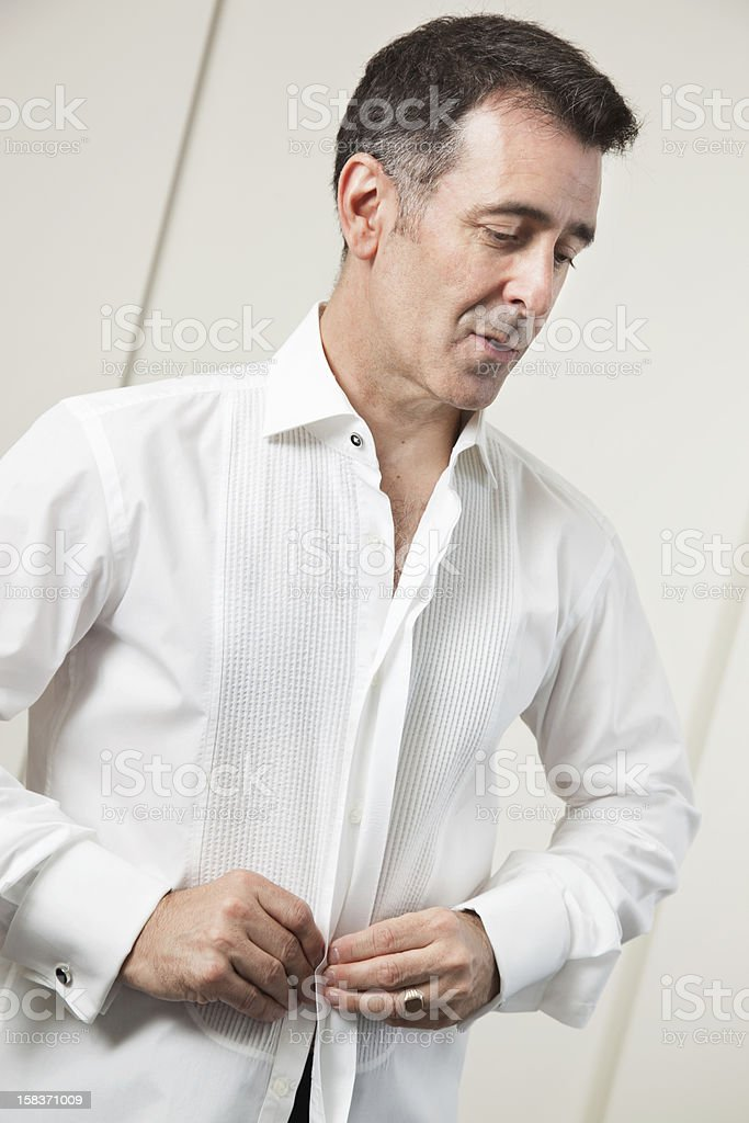 Mature man getting dressed royalty-free stock photo