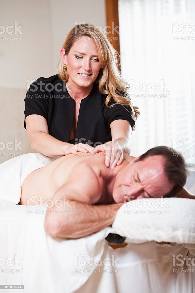 Mature man getting massage royalty-free stock photo