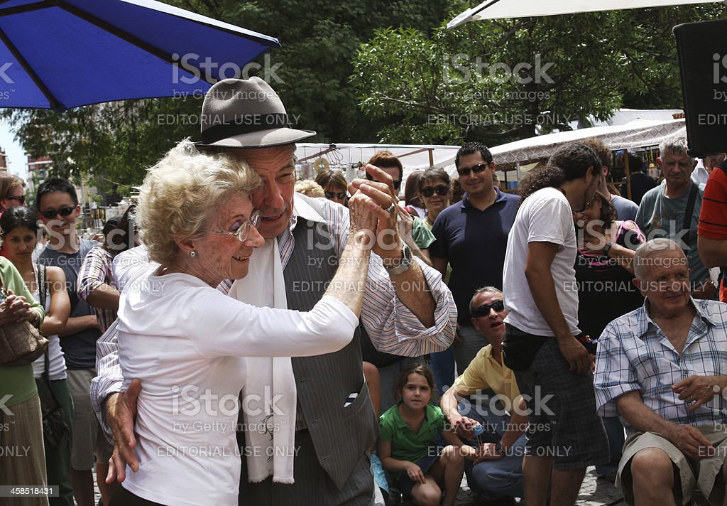 Mature Man Gives Tango Lessons for San Telmo Fair Visitors royalty-free stock photo