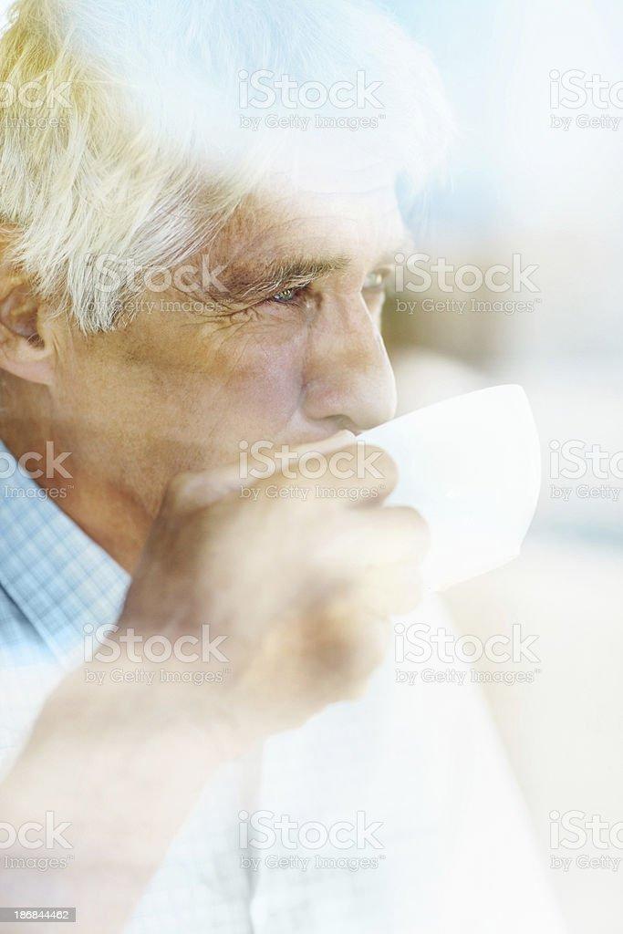 Mature man having coffee stock photo
