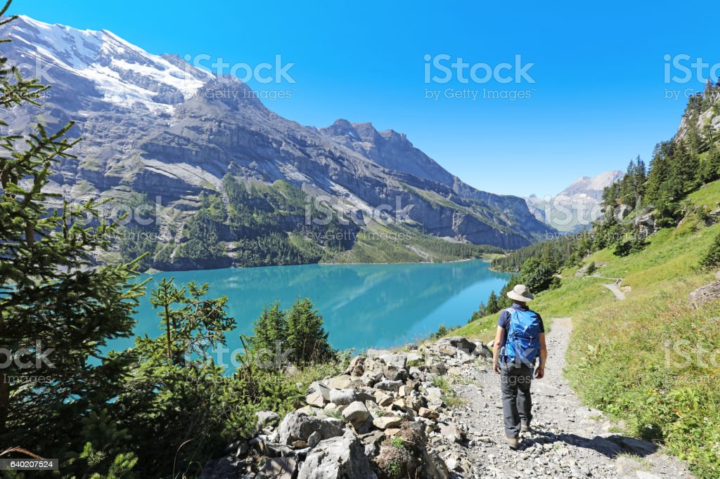 Mature Man Hiking in the Mountains in Switzerland stock photo