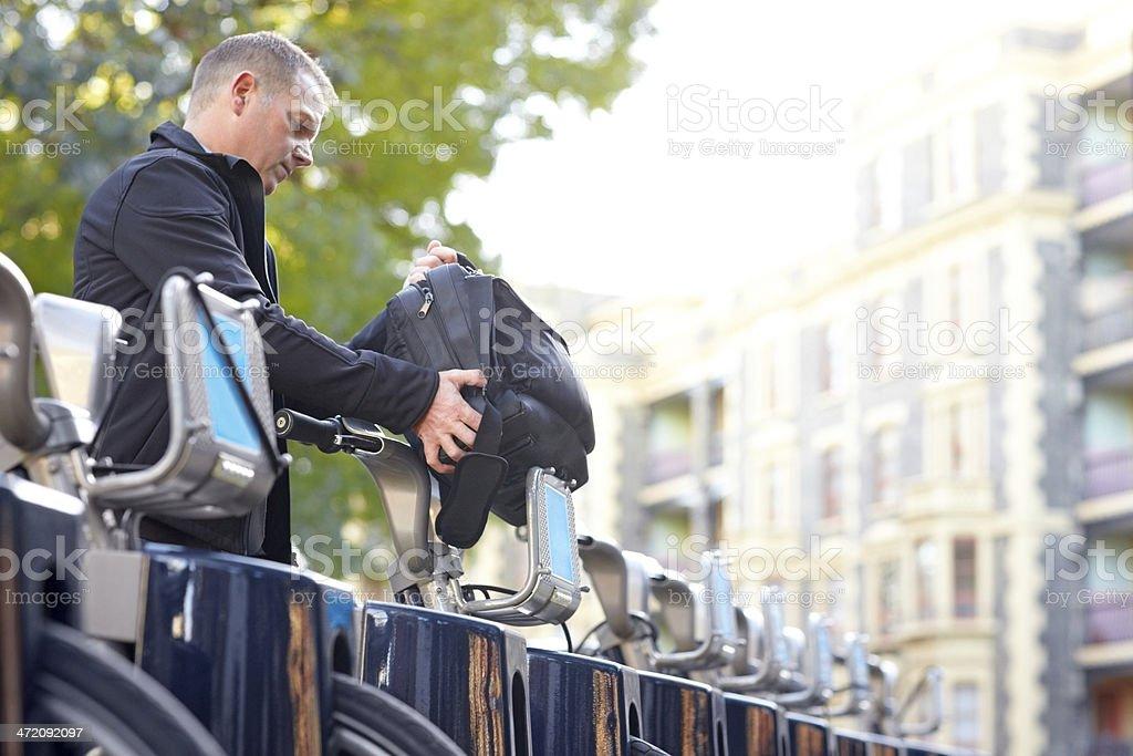 Mature man hiring a bicycle stock photo