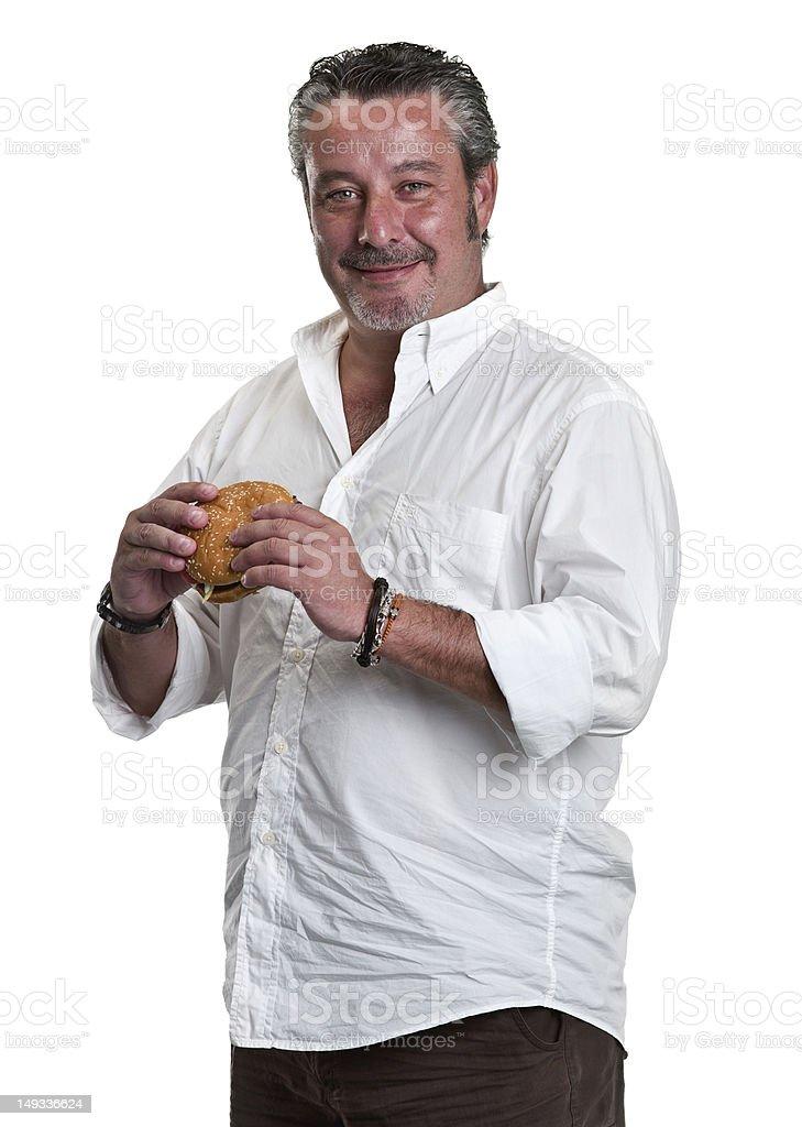 Mature man holding a hamburger stock photo
