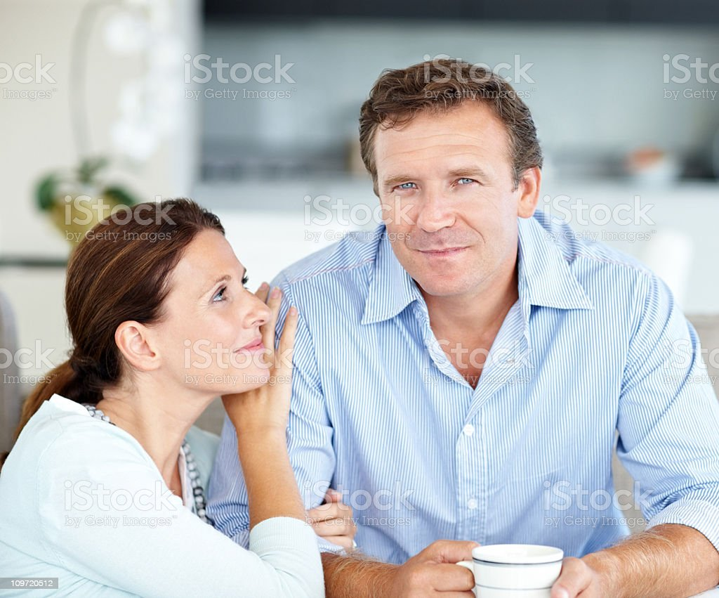 Mature man holding coffee cup while lady looking at him royalty-free stock photo