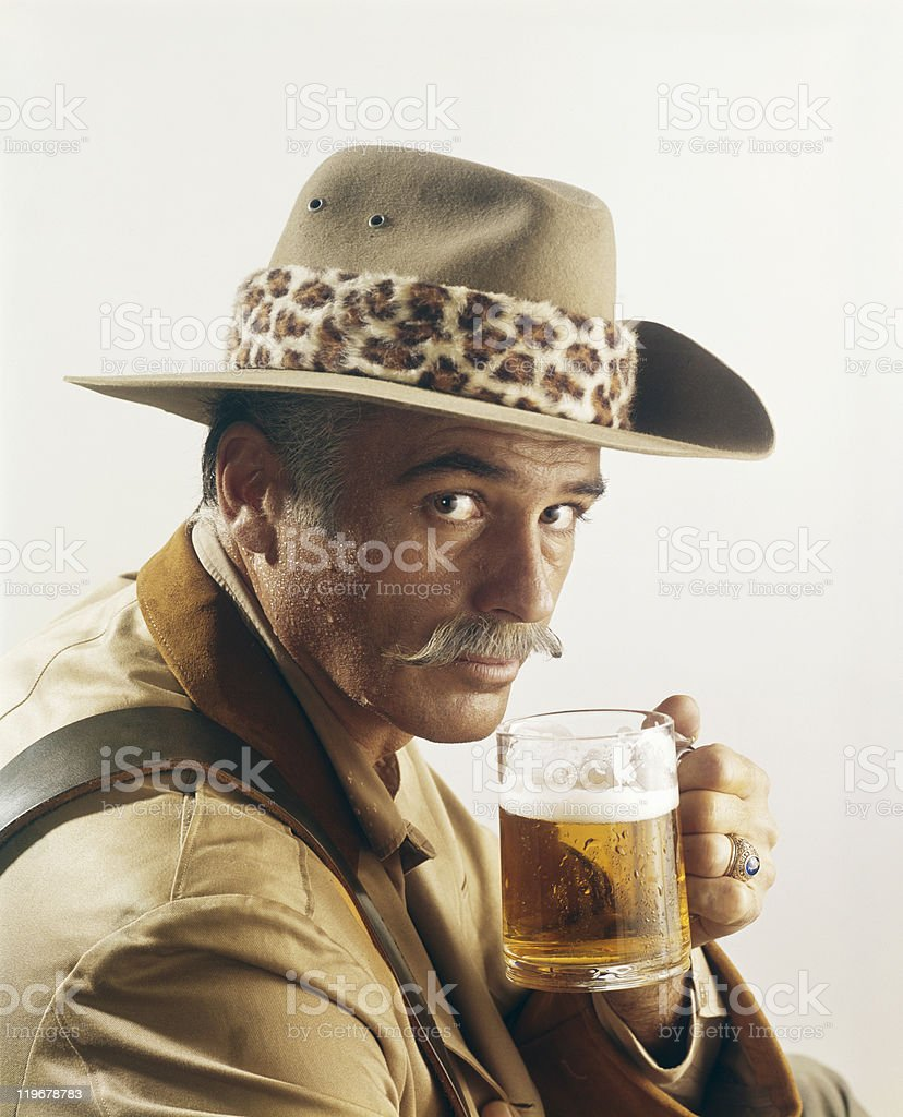 Mature man holding glass of beer, portrait royalty-free stock photo