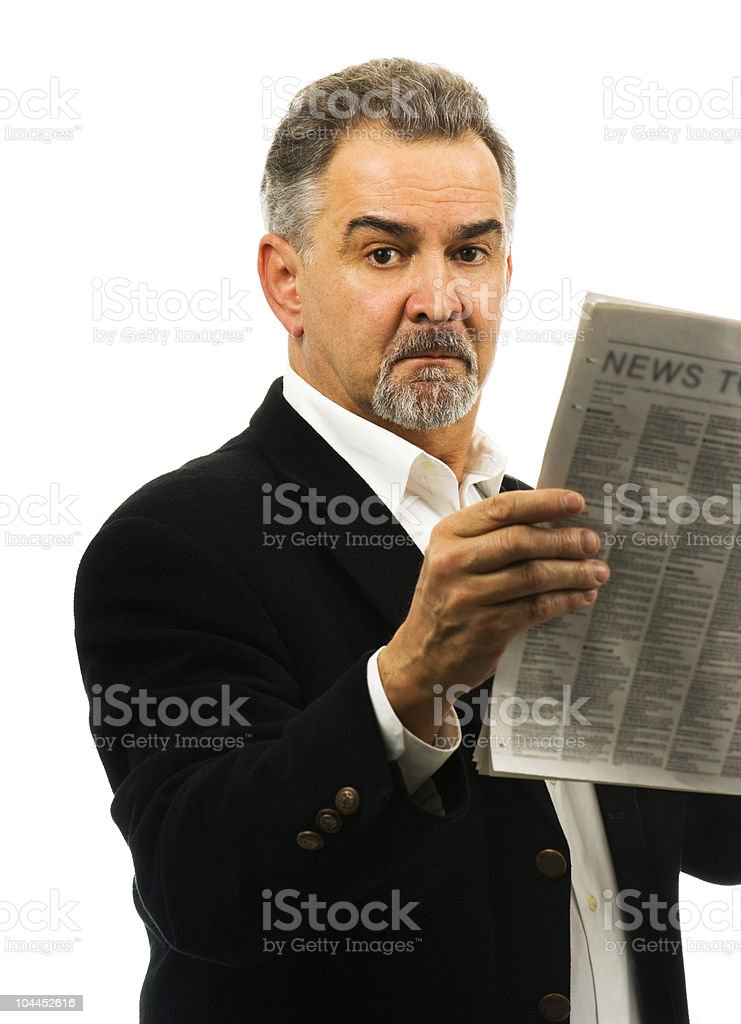 Mature man holds a newspaper, looking serious. royalty-free stock photo