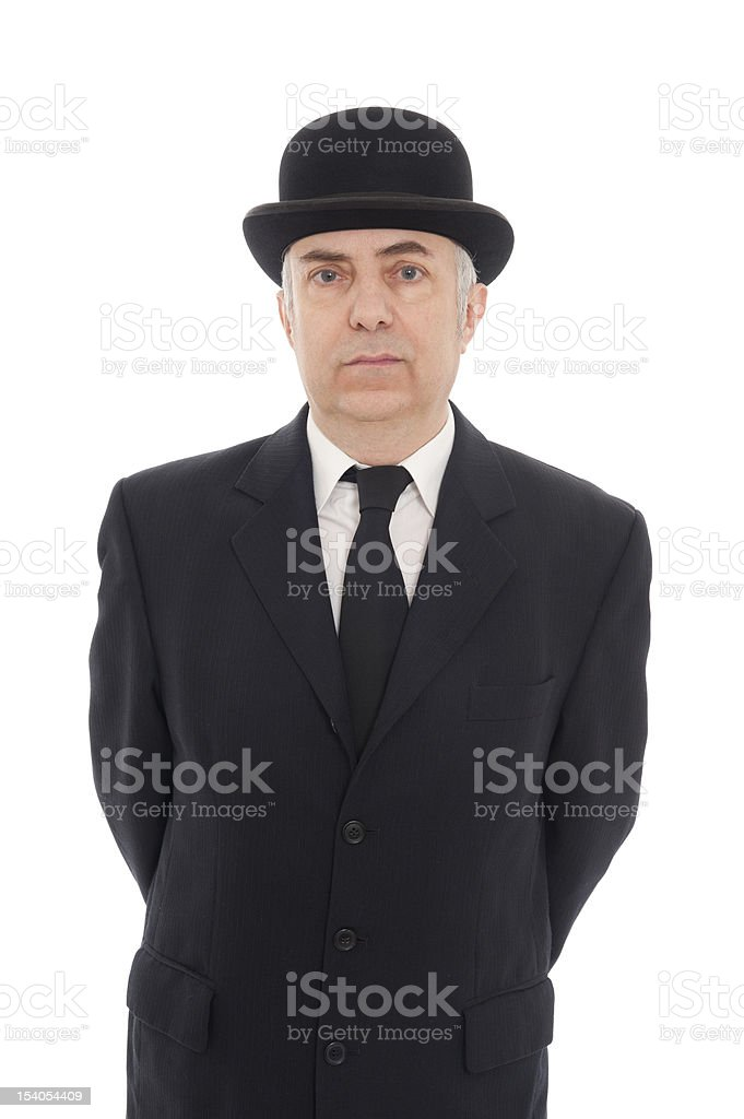 Mature man in a black suit, tie, and top hat stock photo
