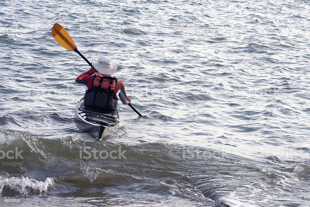 Mature man in canoe. stock photo