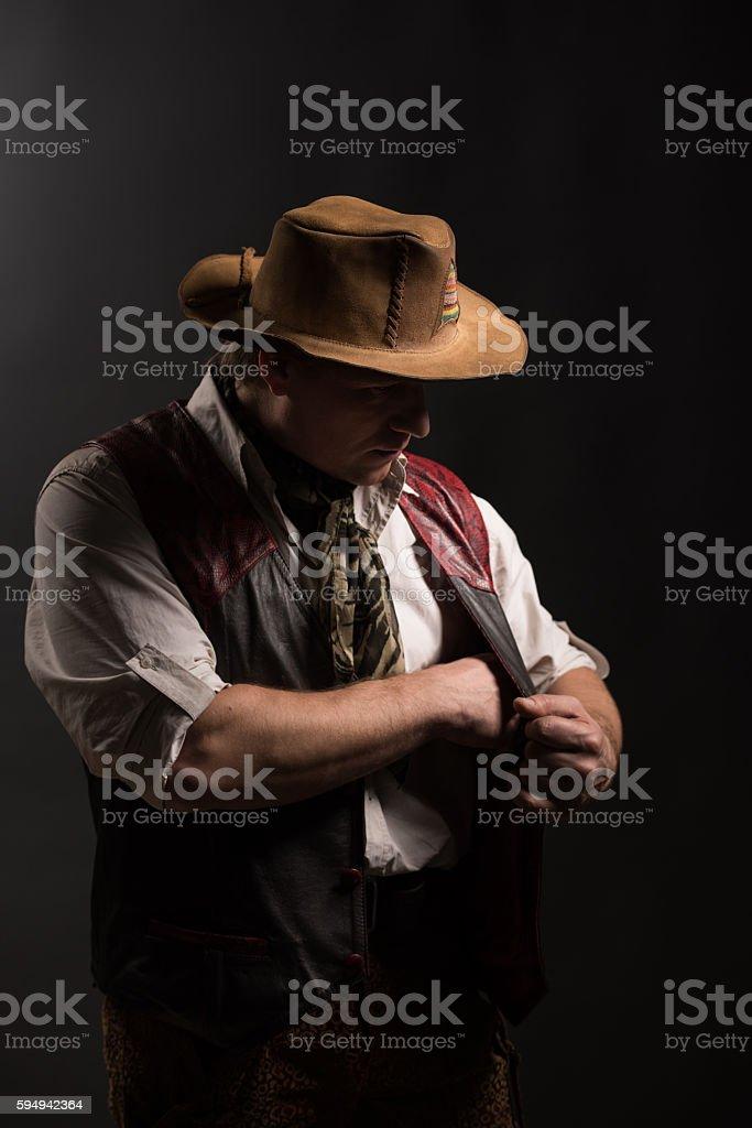 Mature man in costume of traveler old gun stock photo