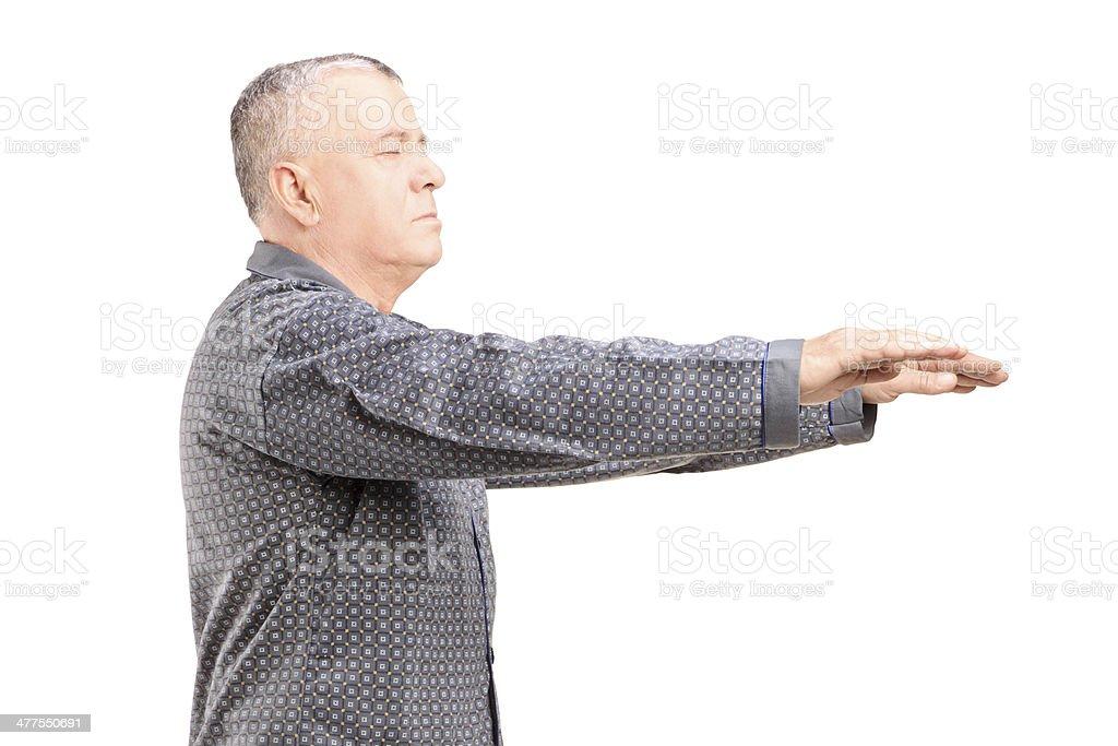 Mature man in pajamas sleepwalking stock photo