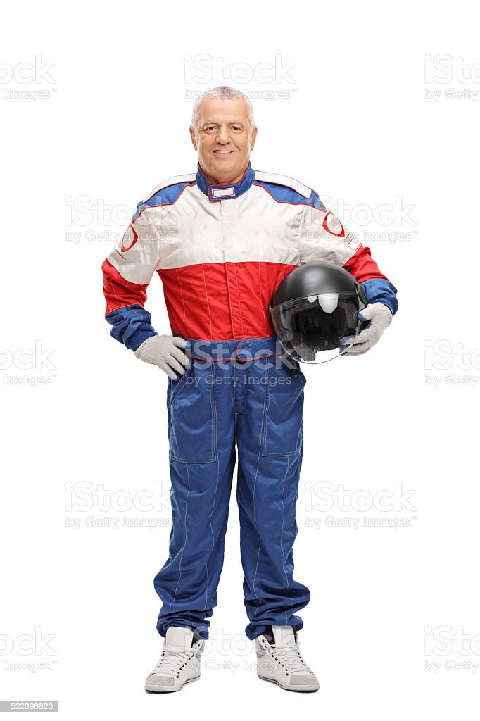 Mature man in racing suit holding helmet stock photo