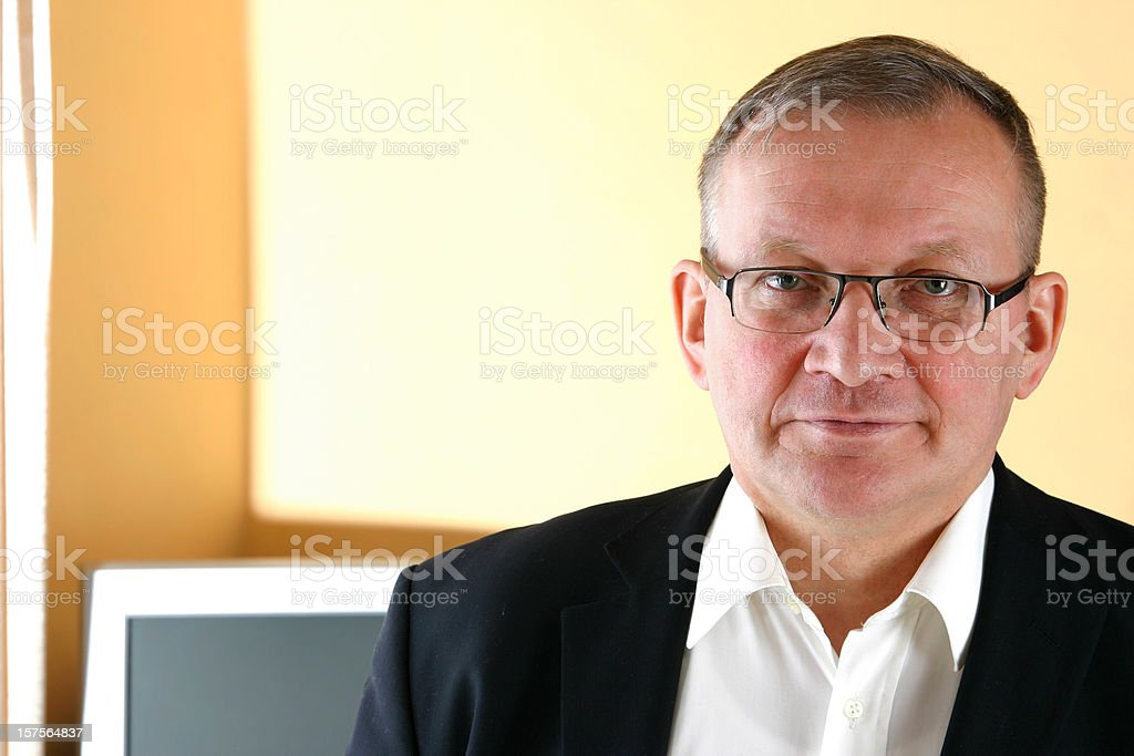 Mature man in the office stock photo