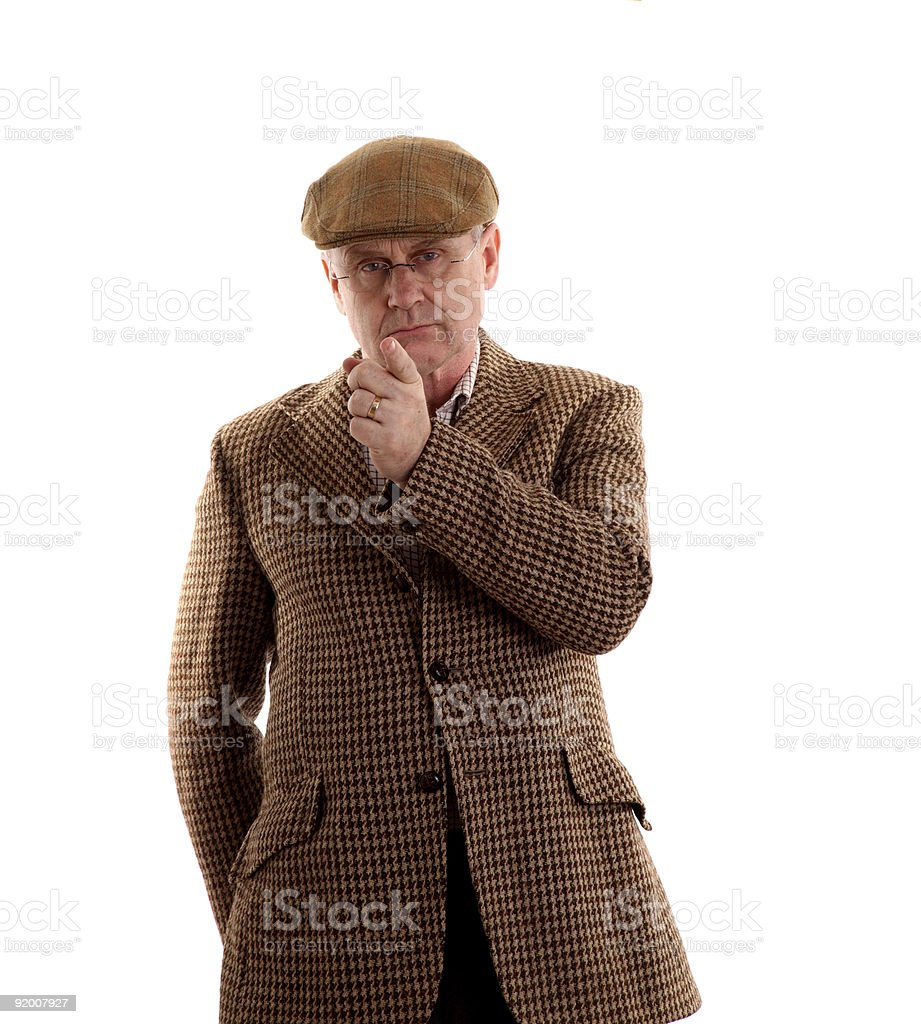 Mature man in tweeds pointing at you stock photo