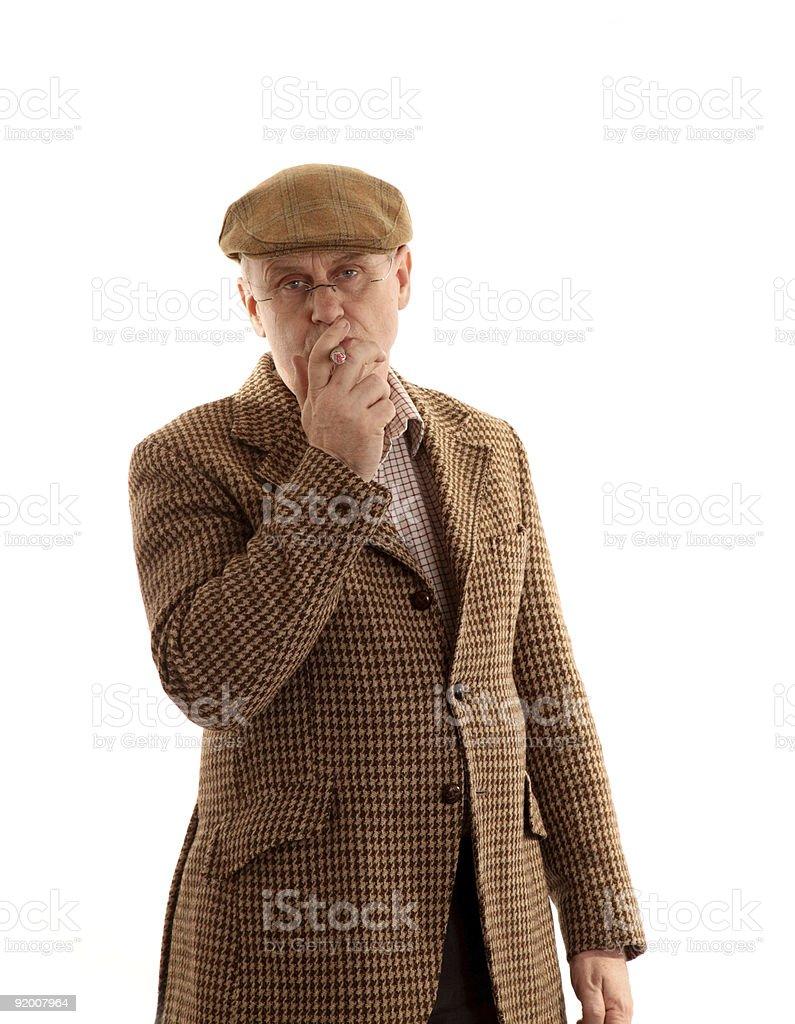 Mature man in tweeds smoking a large cigar stock photo