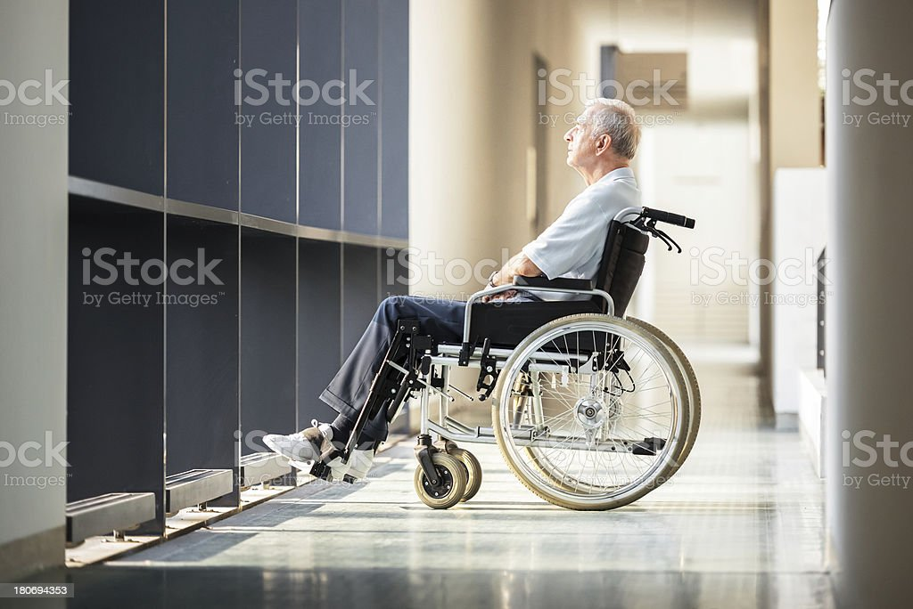 Mature Man in Wheelchair stock photo