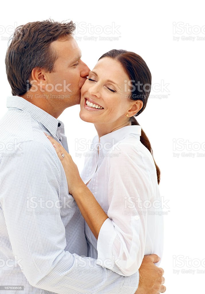 Mature man kissing his wife royalty-free stock photo