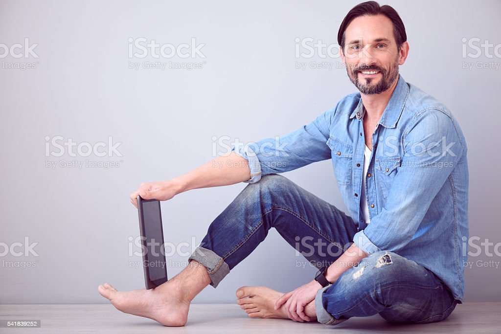 Mature man looking at camera stock photo