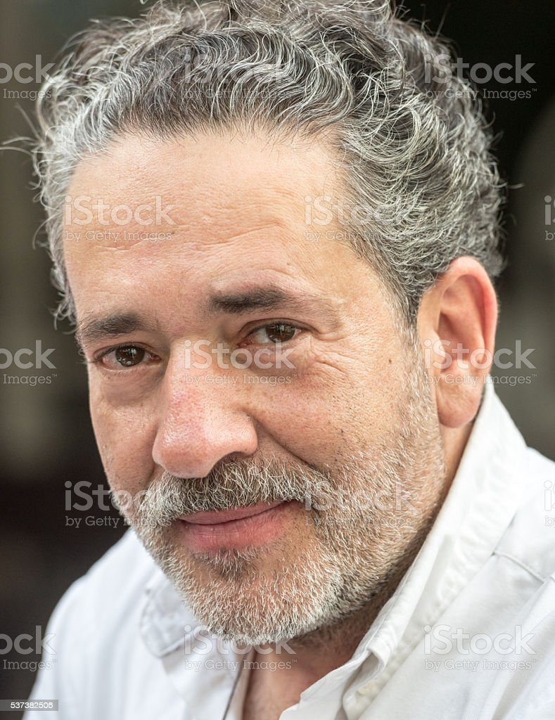 Mature man looking at the camera stock photo