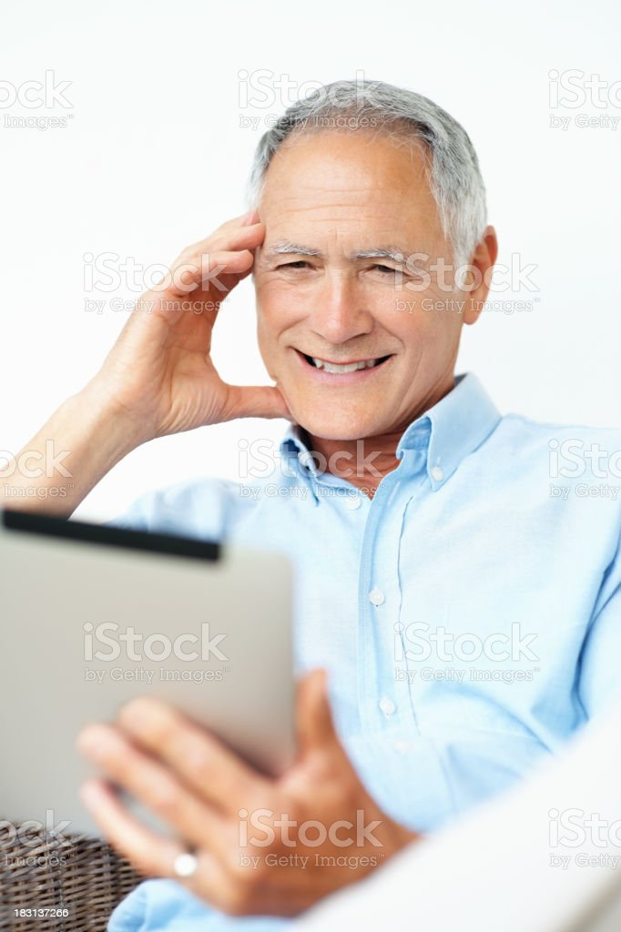 Mature man looking at touchpad screen isolated against white royalty-free stock photo