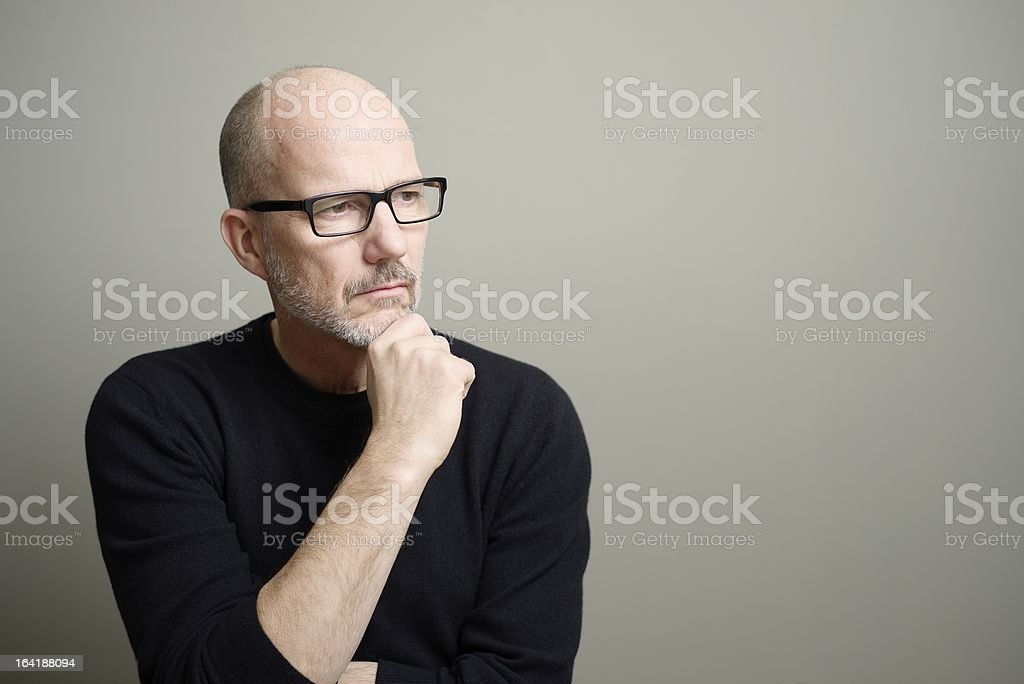 Mature Man Looking Away and Thinking stock photo