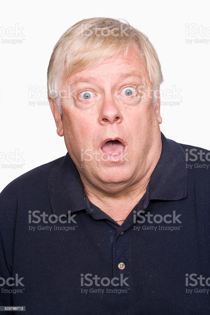 Mature man looking surprised stock photo