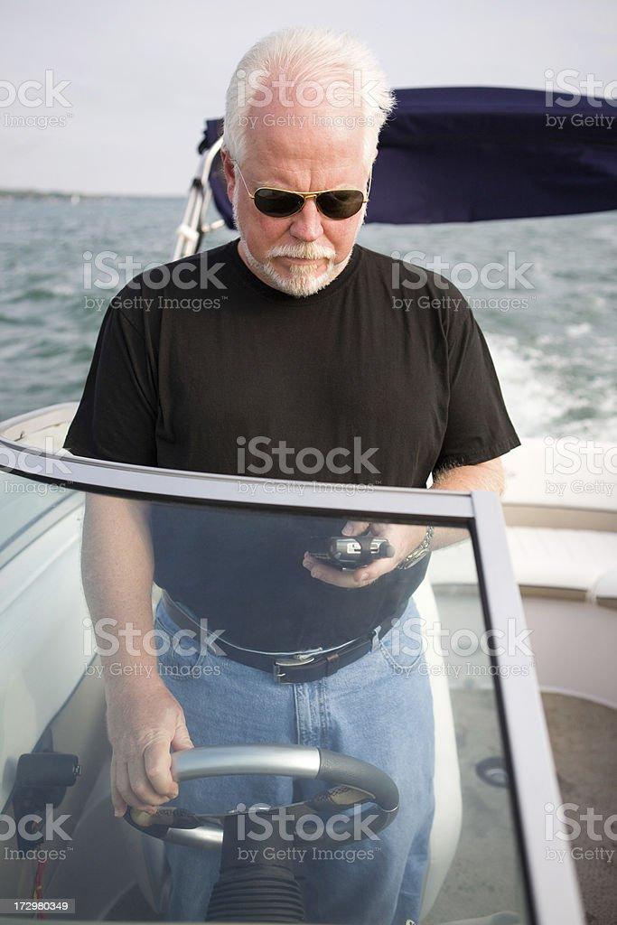 mature man multi-tasking royalty-free stock photo