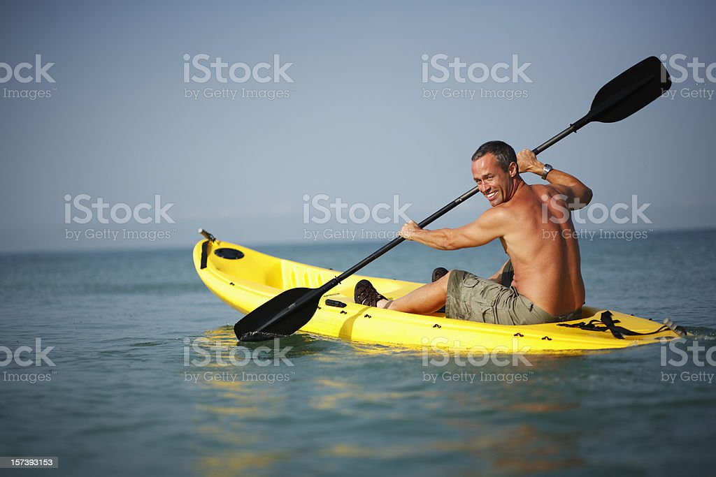 Mature man on kayak in the sea royalty-free stock photo
