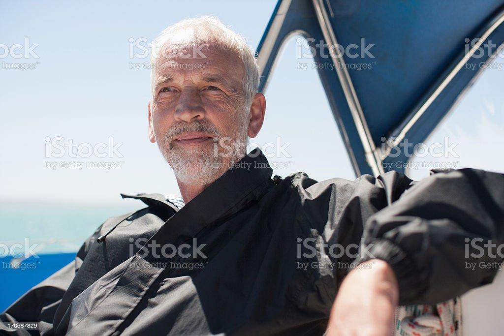 Mature man on sailboat royalty-free stock photo