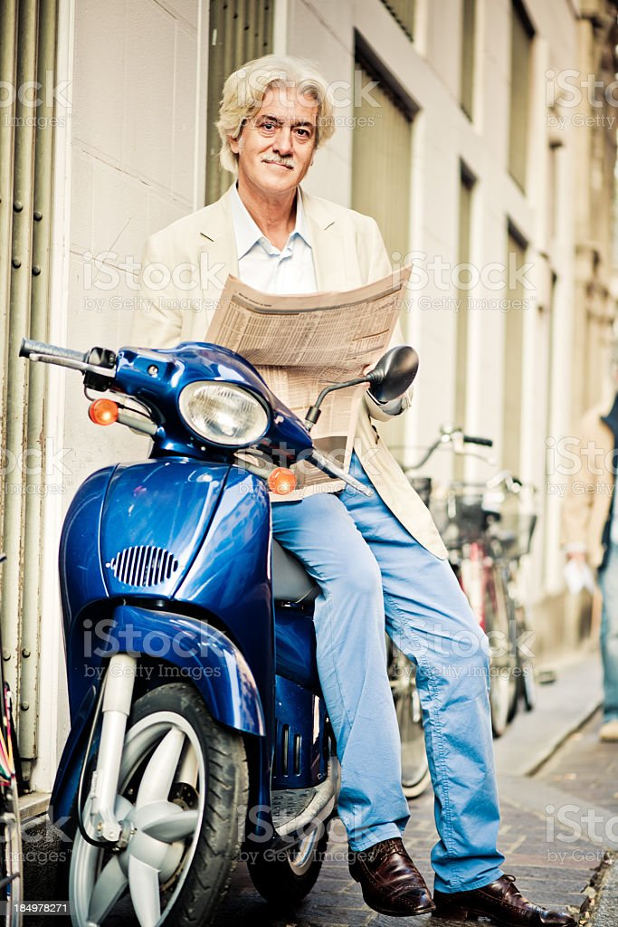 Mature man on scooter royalty-free stock photo