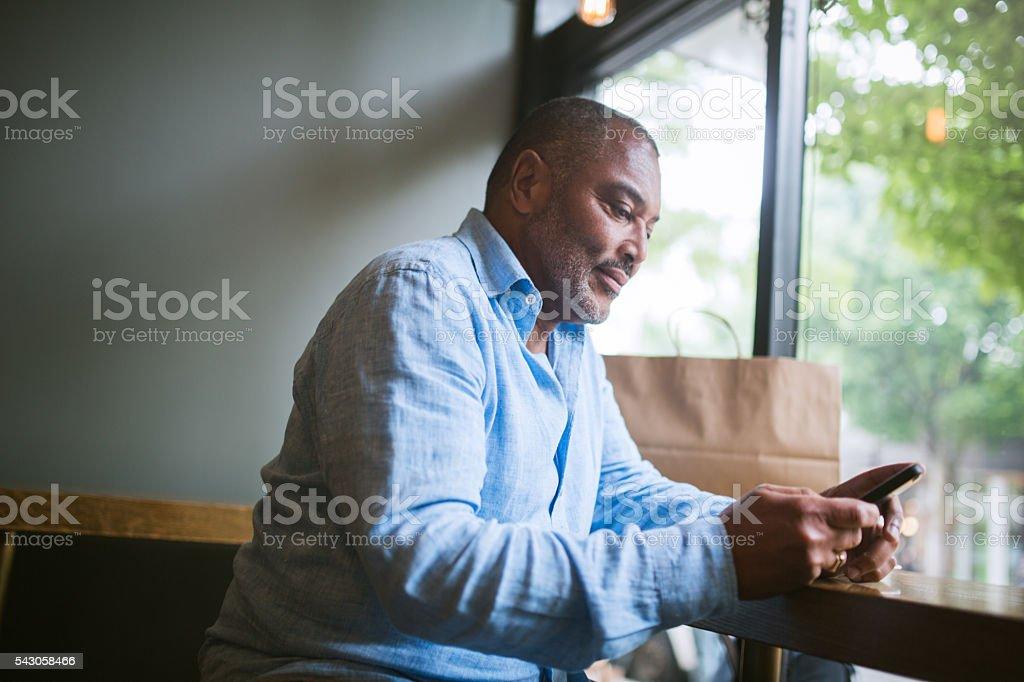 Mature Man on Smart Phone stock photo