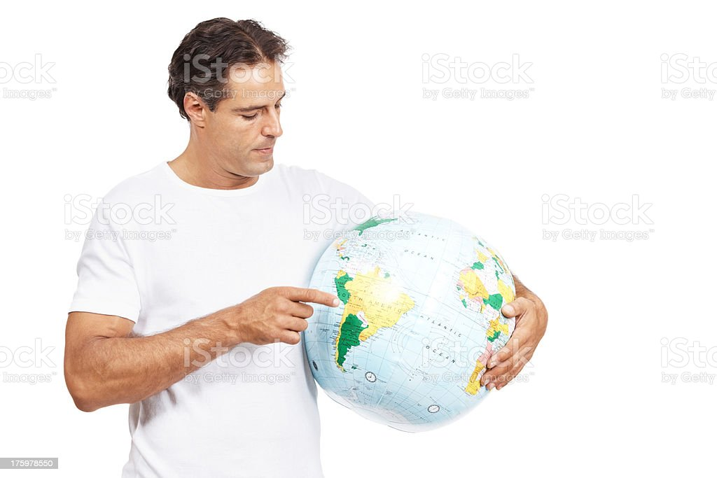 Mature man pointing at a terrestrial globe in his hand isolated on white stock photo