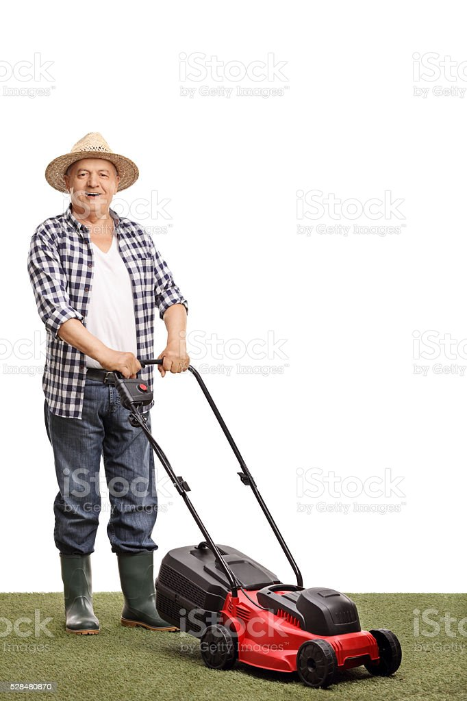 Mature man posing with a lawnmower stock photo