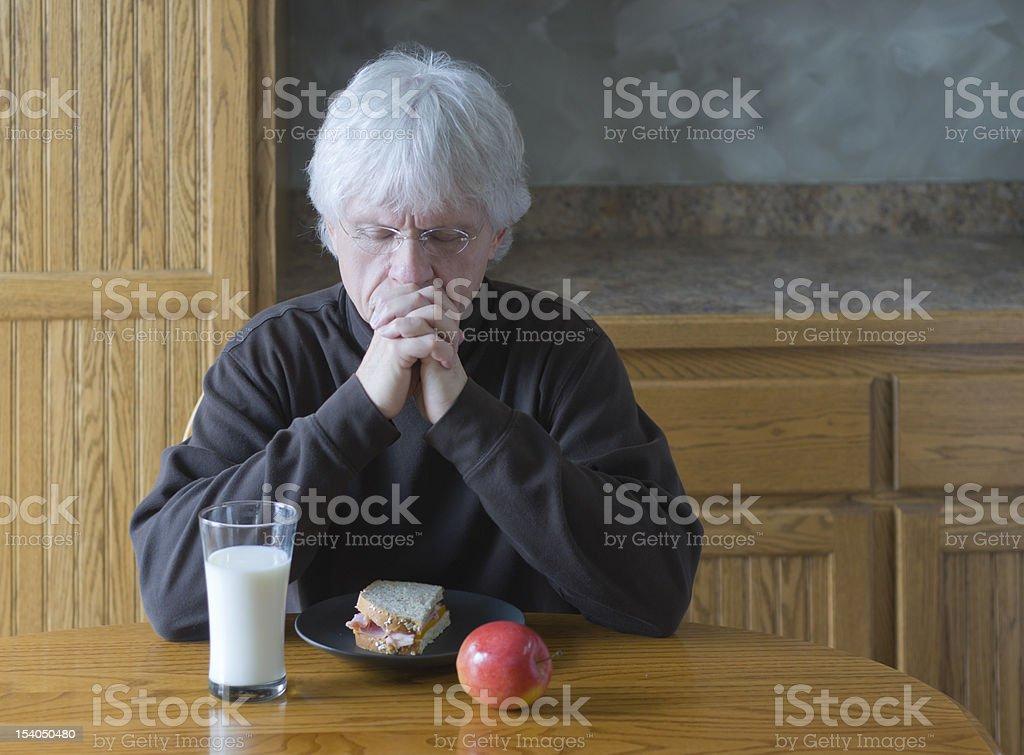 Mature Man Praying Before Eating royalty-free stock photo