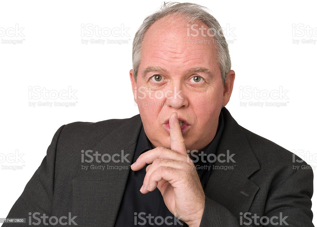 Mature Man Puts Finger To Lips Gesturing Quiet Sign royalty-free stock photo