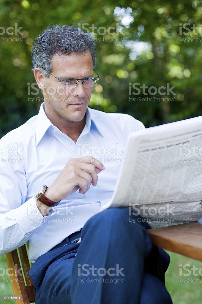 Mature man reading news stock photo