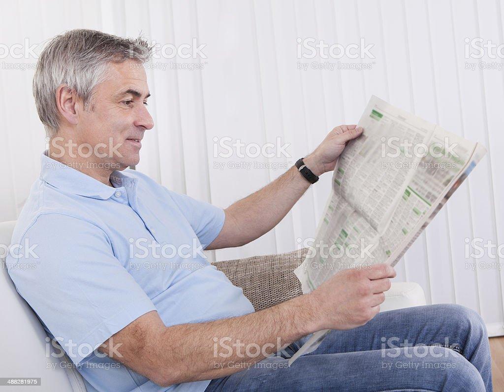 Mature Man Reading Newspaper stock photo