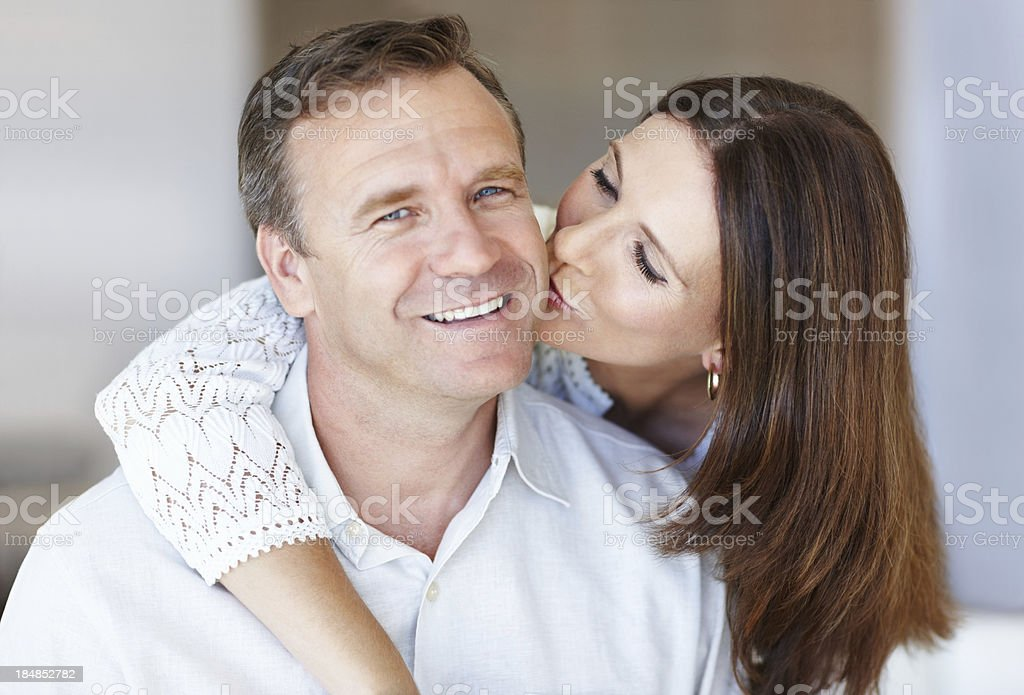 Mature man receiving hug and kiss royalty-free stock photo