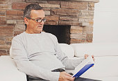 Mature man relaxing with a book
