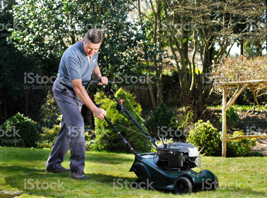 Mature Man/ Senior Mowing The Lawn stock photo