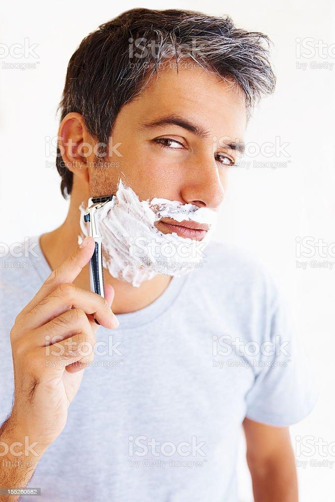 Mature man shaving with razor royalty-free stock photo