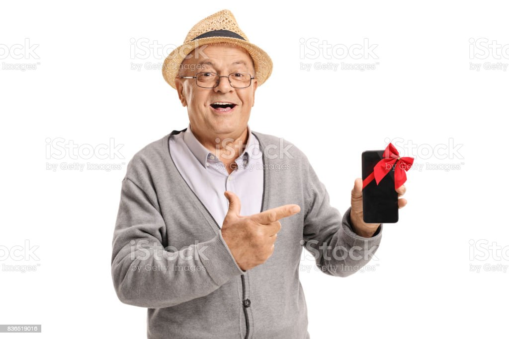Mature man showing a phone wrapped with red ribbon stock photo