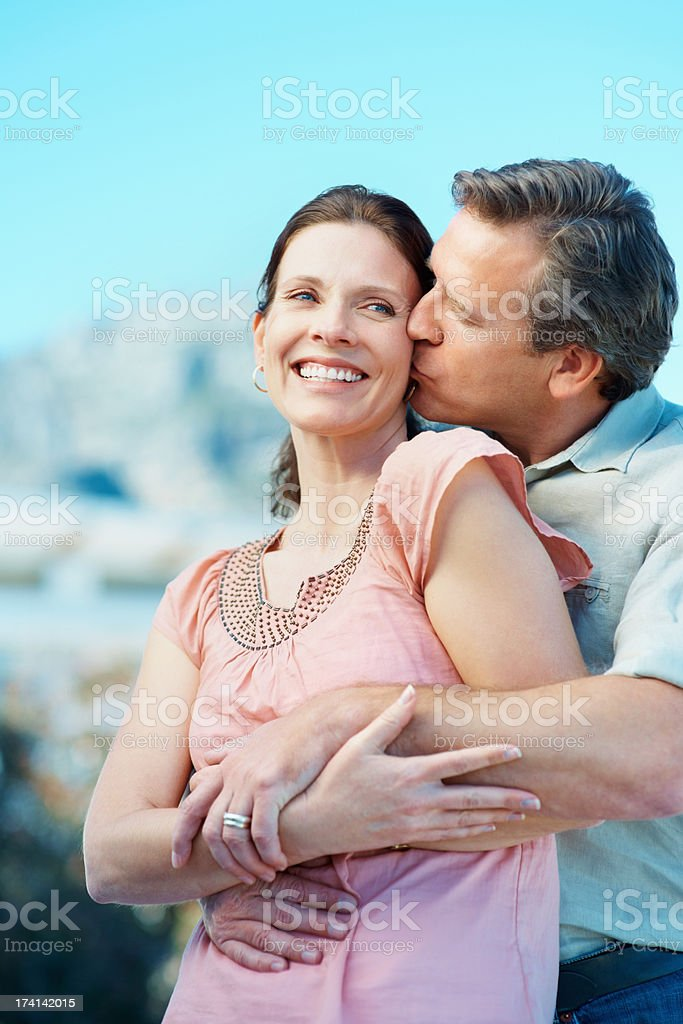Mature man showing affection to a pretty woman stock photo