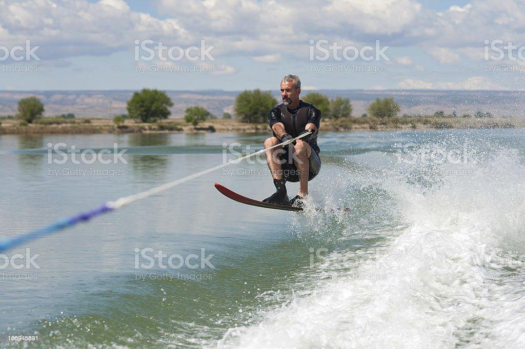 Mature Man Slalom Water Skiing royalty-free stock photo