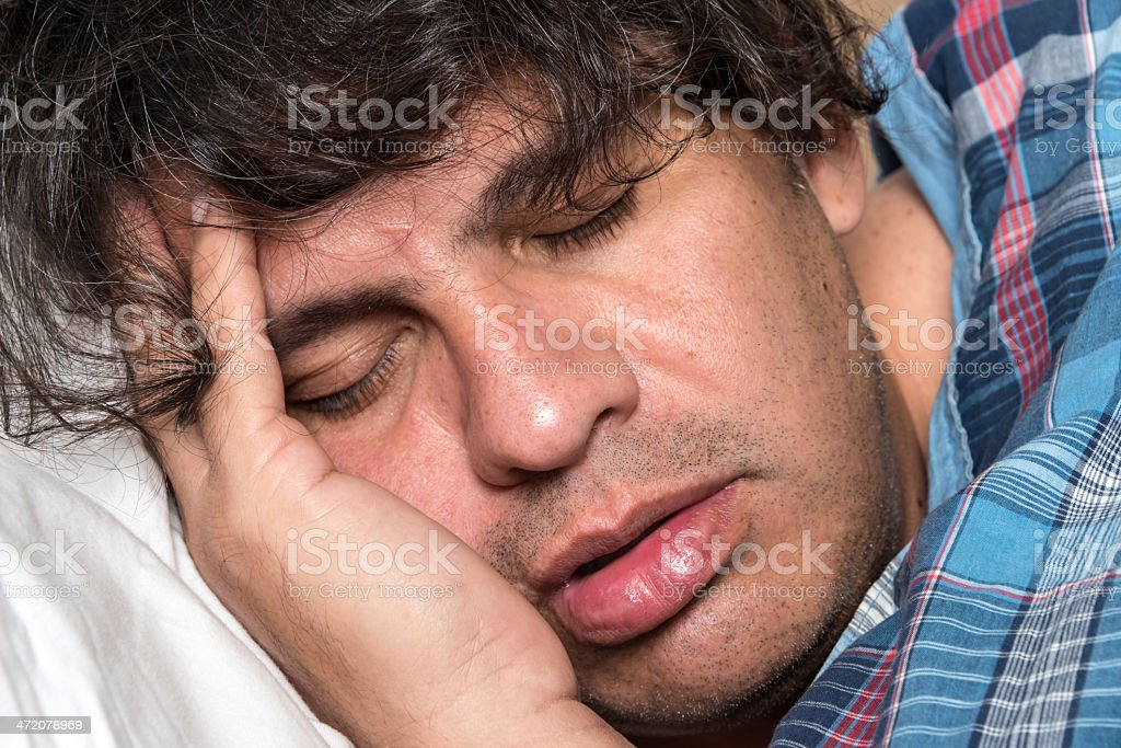 Mature man sleeping royalty-free stock photo