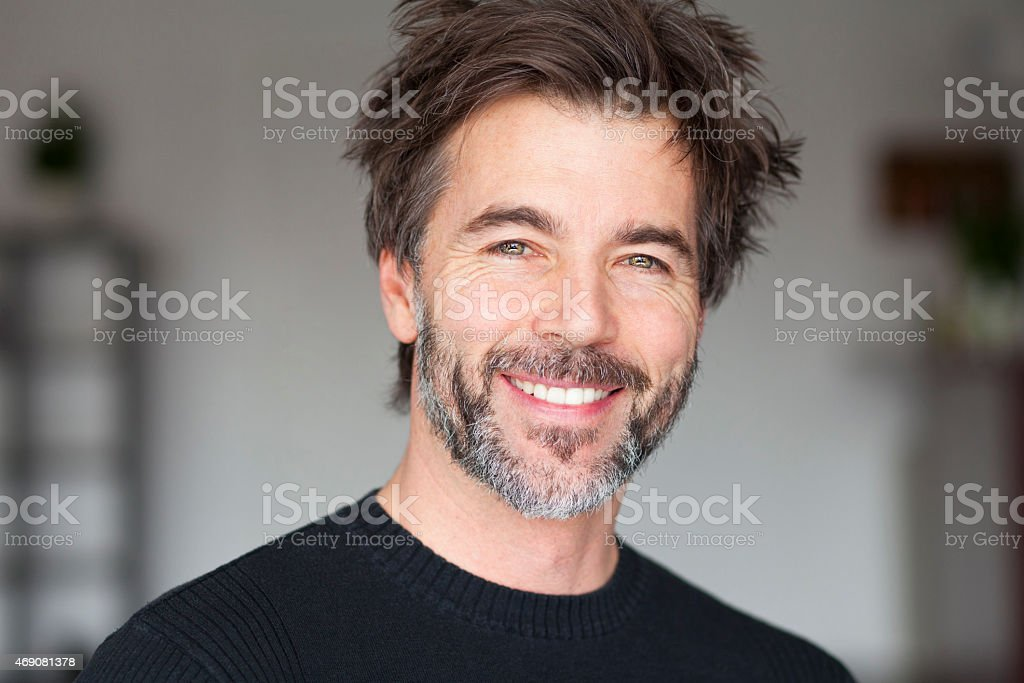Mature Man Smiling And Having Fun stock photo