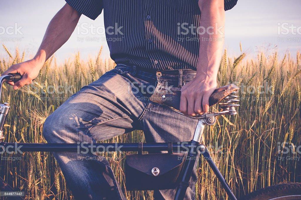 Mature man standing with retro bike stock photo