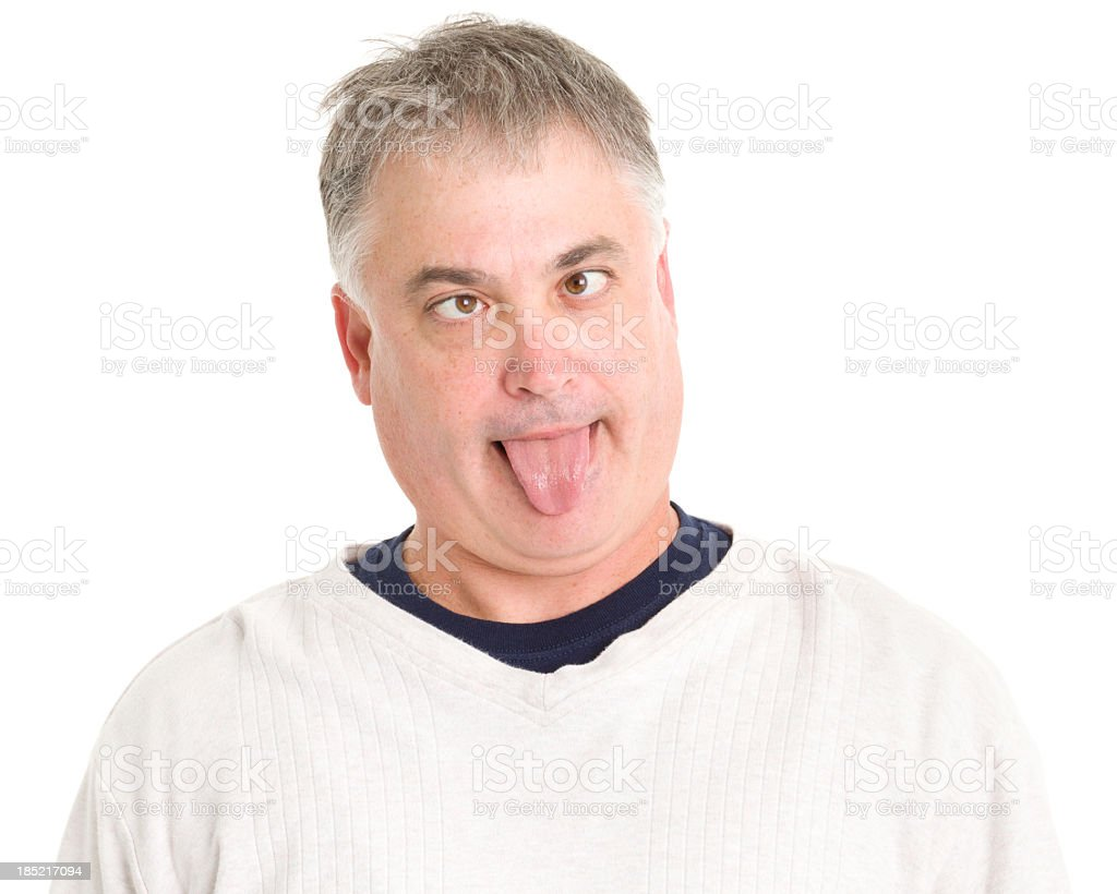 Mature Man Sticks Out Tongue Making Funny Face royalty-free stock photo