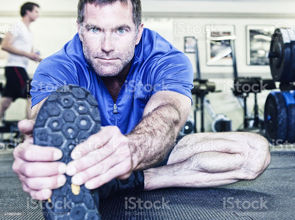 Mature Man Stretching in Gym royalty-free stock photo